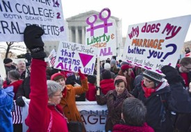 Gay rights supporters rally outside the Supreme Court as justices hear same-sex marriage case.